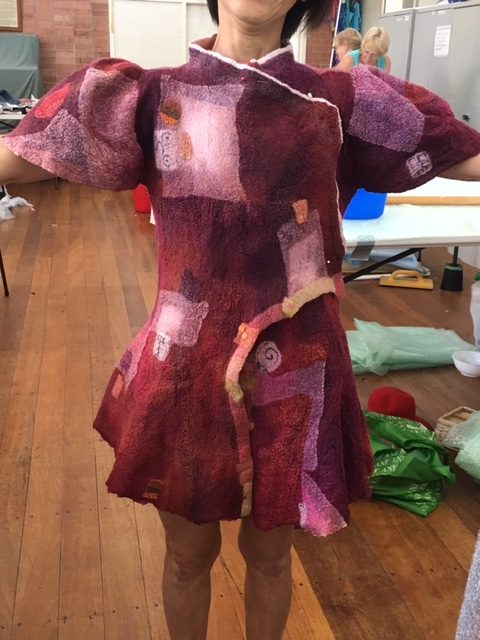 15.-Day-4.-Vimol-tries-on-her-felted-garment-before-final-shaping-e1550718556677
